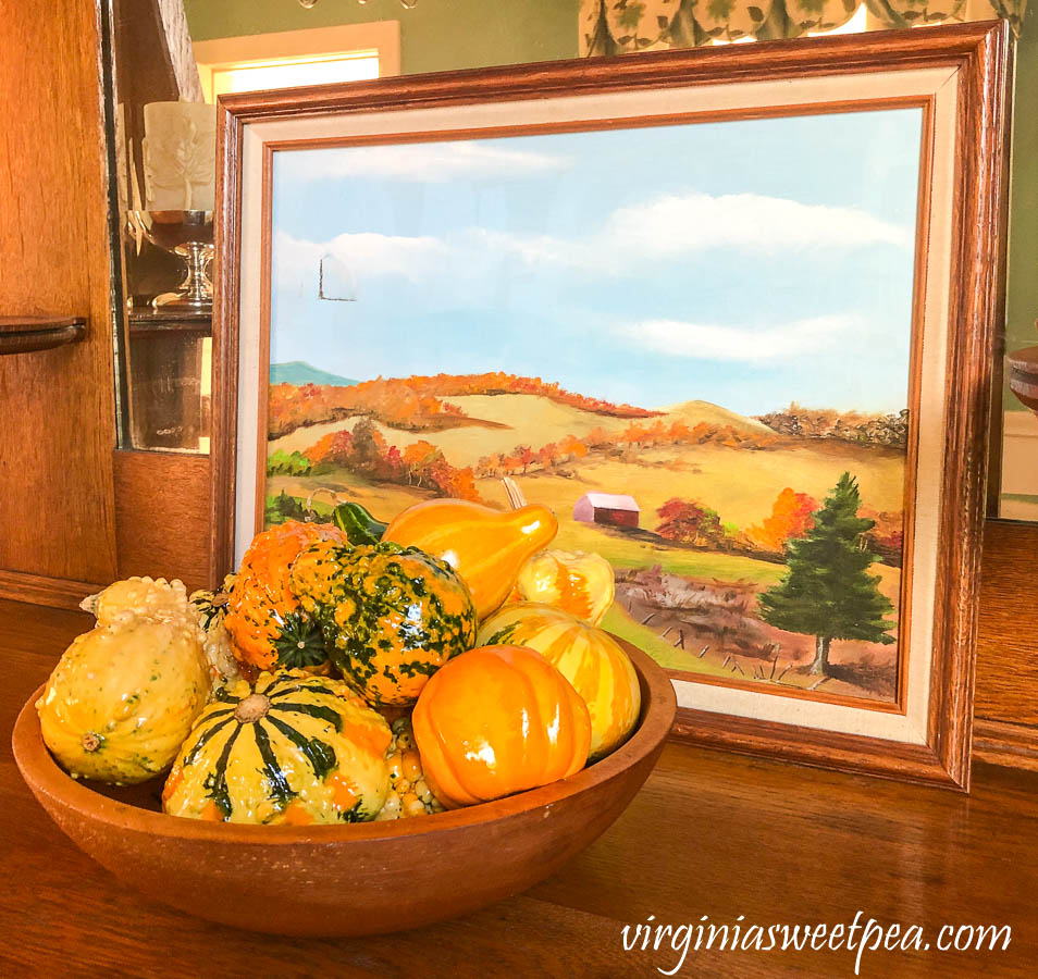Vermont painting with a wooden bowl filled with gourds