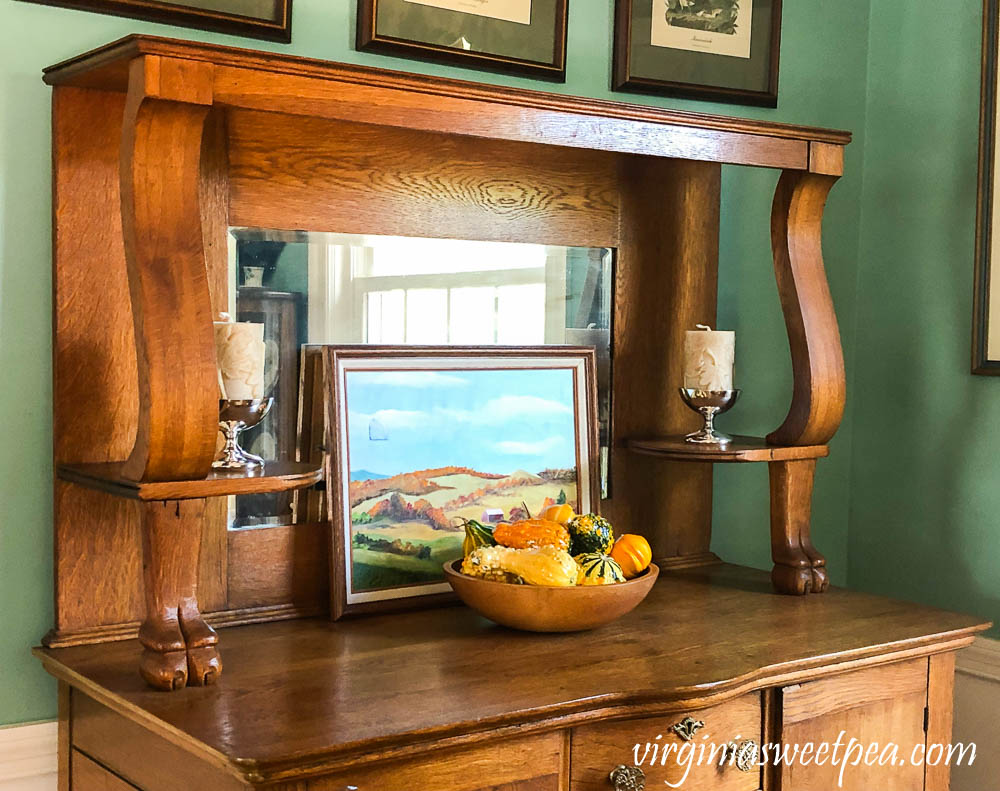 An antique oak buffet decorated for fall