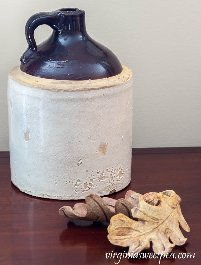 Vintage jug with clay leaves handcrafted in Seagrove, NC