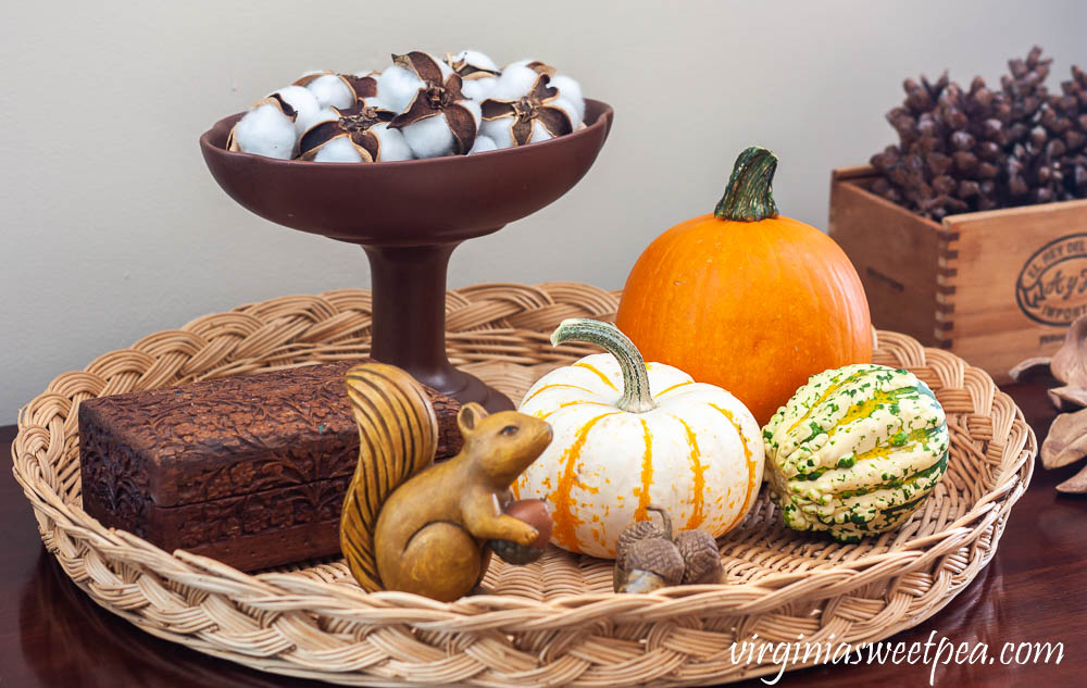 Fall Vignette with wood squirrel, handmade clay acorns, wood box from India, Hagar compote filled with cotton bolls and a cigar box filled with pinecones.