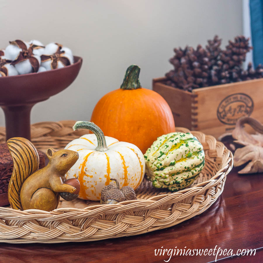 Fall vignette with pumpkins, handmade clay leaves and acorns, cotton bolls in a Hagar compote, and pinecones in a cigar box.