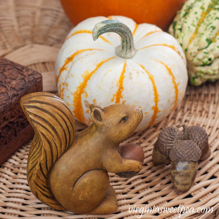 Wood squirrel, handmade clay acorns and a baby pumpkin used in a fall vignette