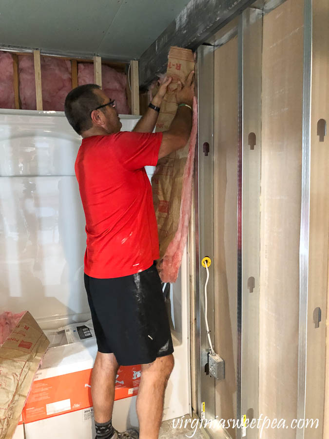 Adding insulation to the basement bathroom.