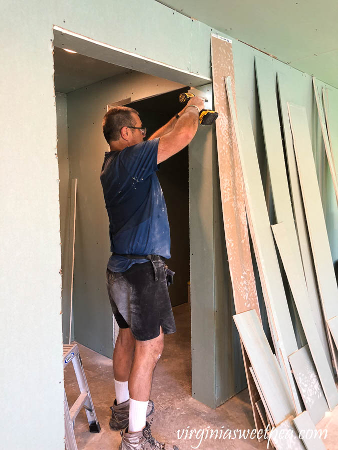 Installing drywall in a basement at Smith Mountain Lake