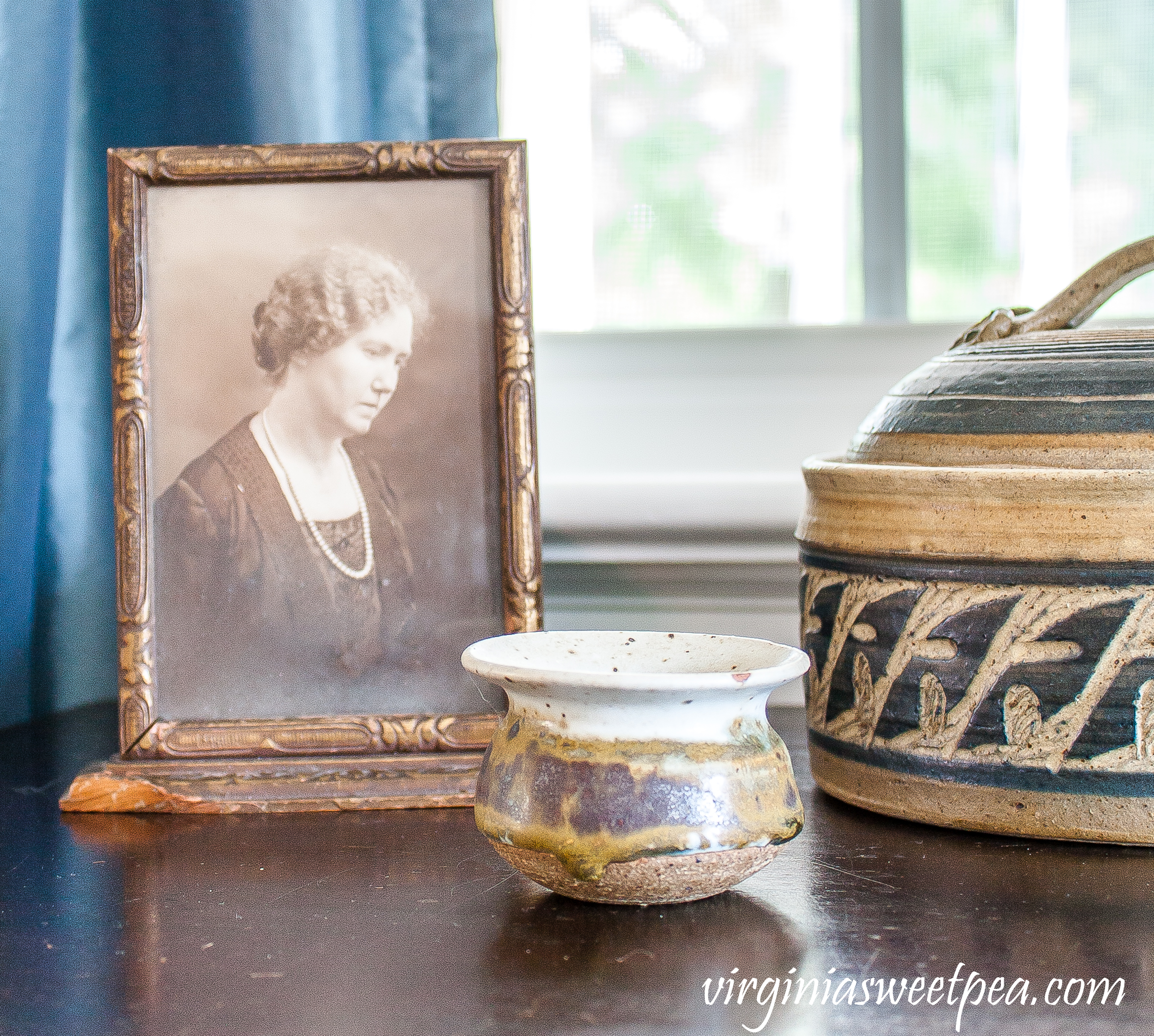 Vintage pottery used in an early fall vignette