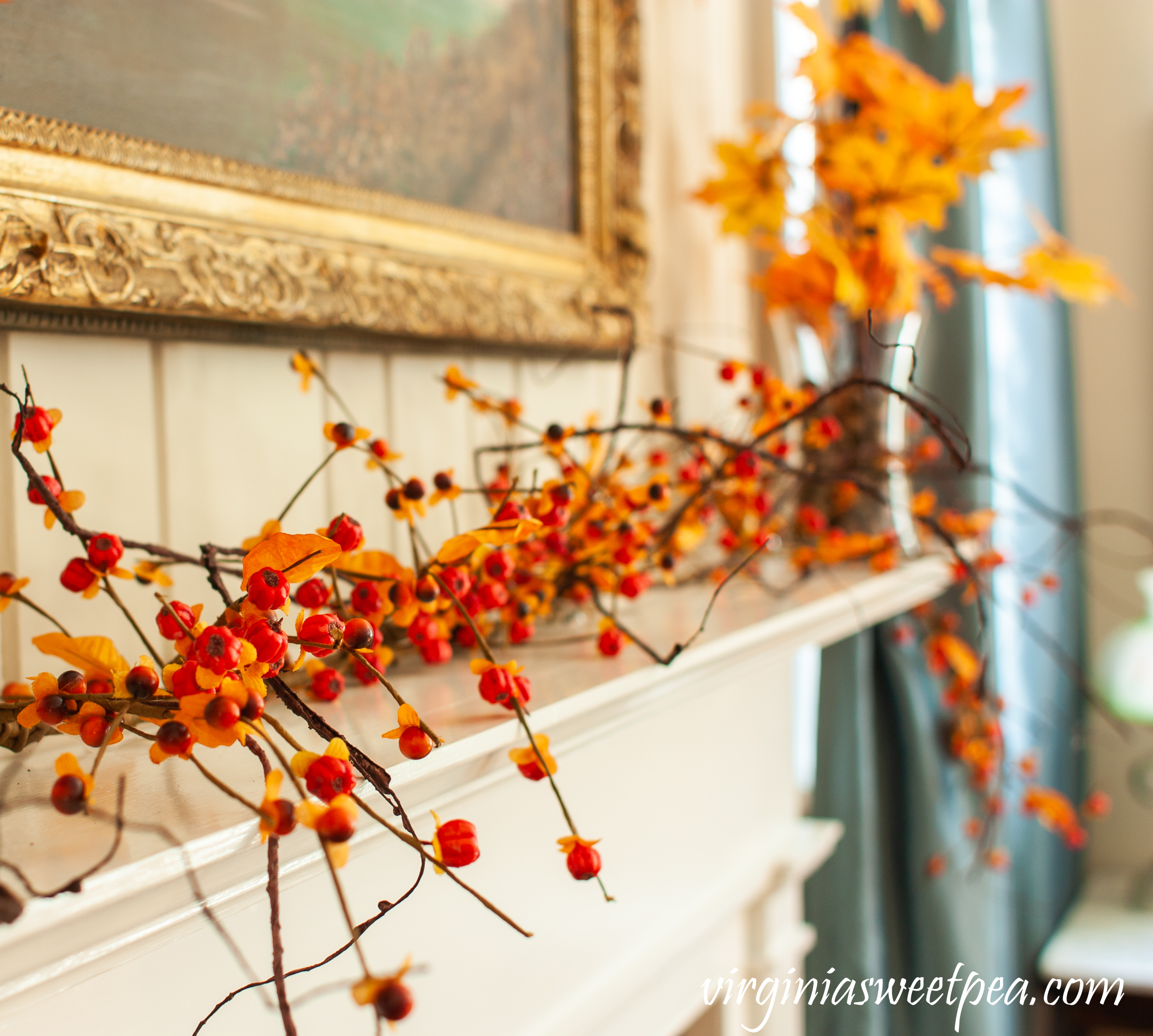 Bittersweet used to decorate a mantel for fall.