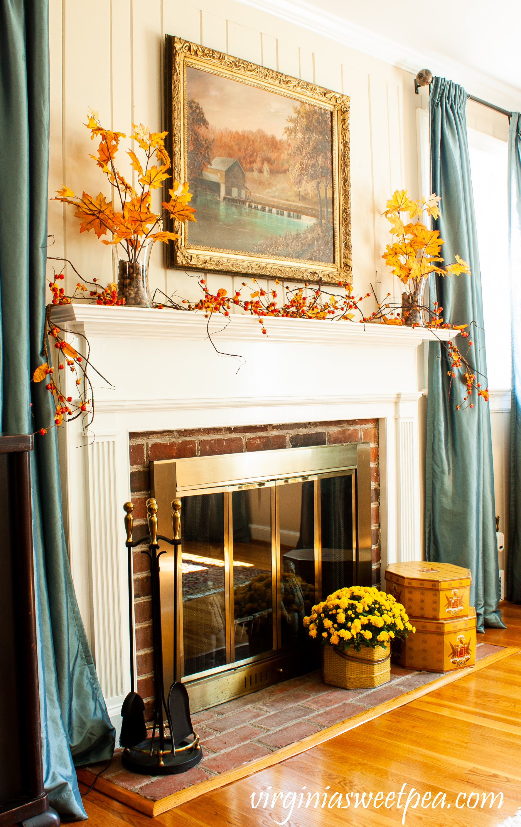 Traditional Fall Mantel - A mantel decorated with a painting of a mill in Sussex County, NJ along with fall foliage, bittersweet, and mums.