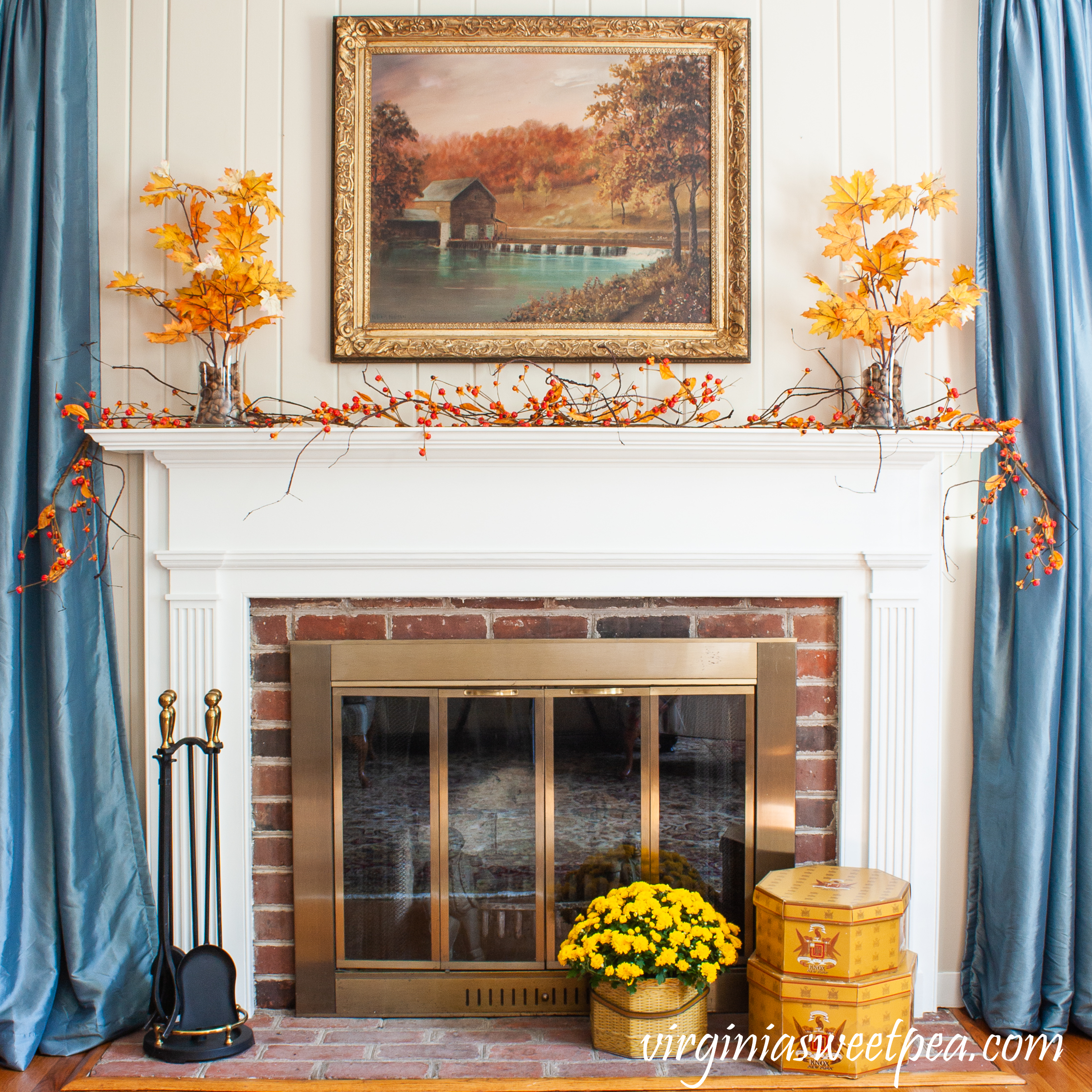 Traditional Fall Mantel - A mantel is decorated for fall with fall foliage, bittersweet, and mums.