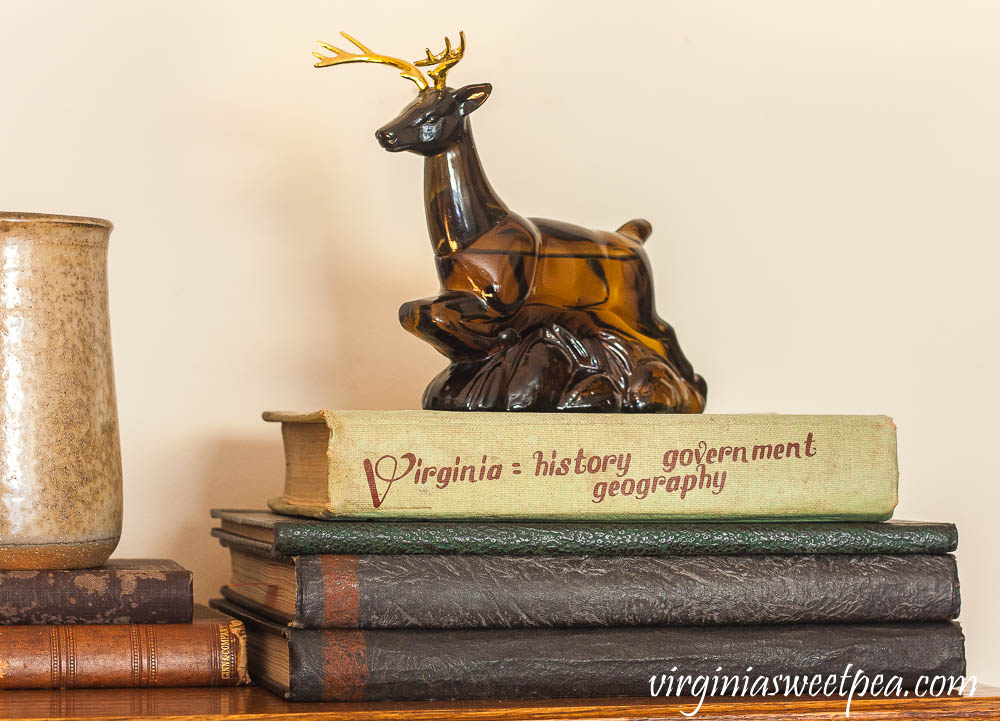 Avon Ten-Point buck Wild Country After Shave Bottle, a 1964 Virginia History Textbook, and yearbooks from Roanoke College in the late 1920's.