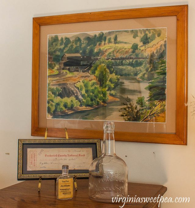 Emlyn Edwards painting with Ahalt distillery in Middletown, Maryland whiskey bottle and bank receipt.