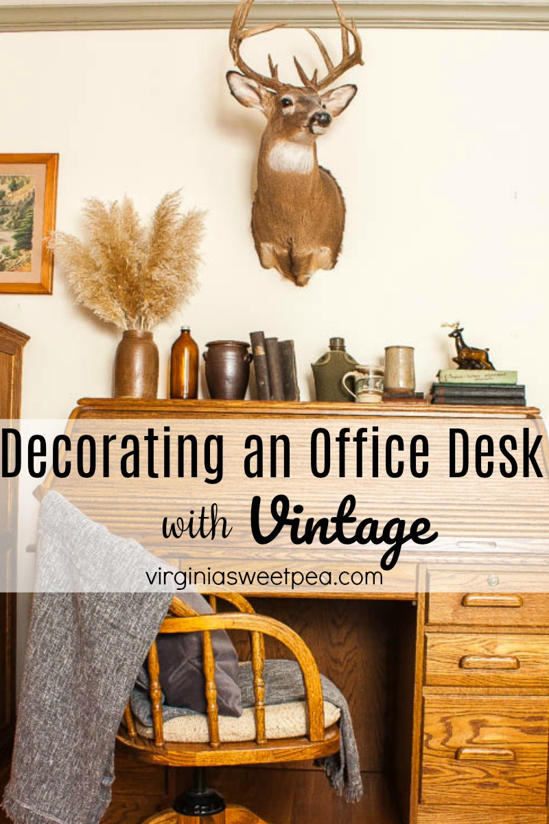 Decorating an Office Desk with Vintage - Learn how to decorate a man's office desk with vintage with both a cabin and masculine feel.  #mancave #cabindecor #deskdecor #maledeskdecor #deerdecor #decoratewithdeer via @spaula