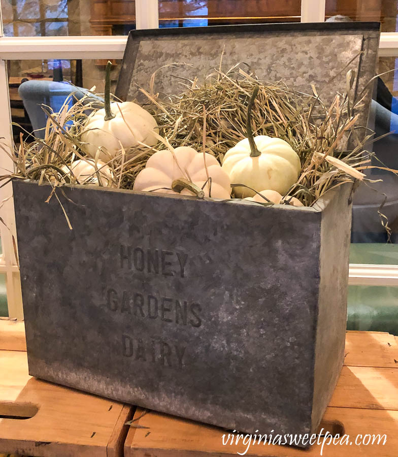 Vintage milk box decorated for fall at the Woodstock Inn in Woodstock, Vermont