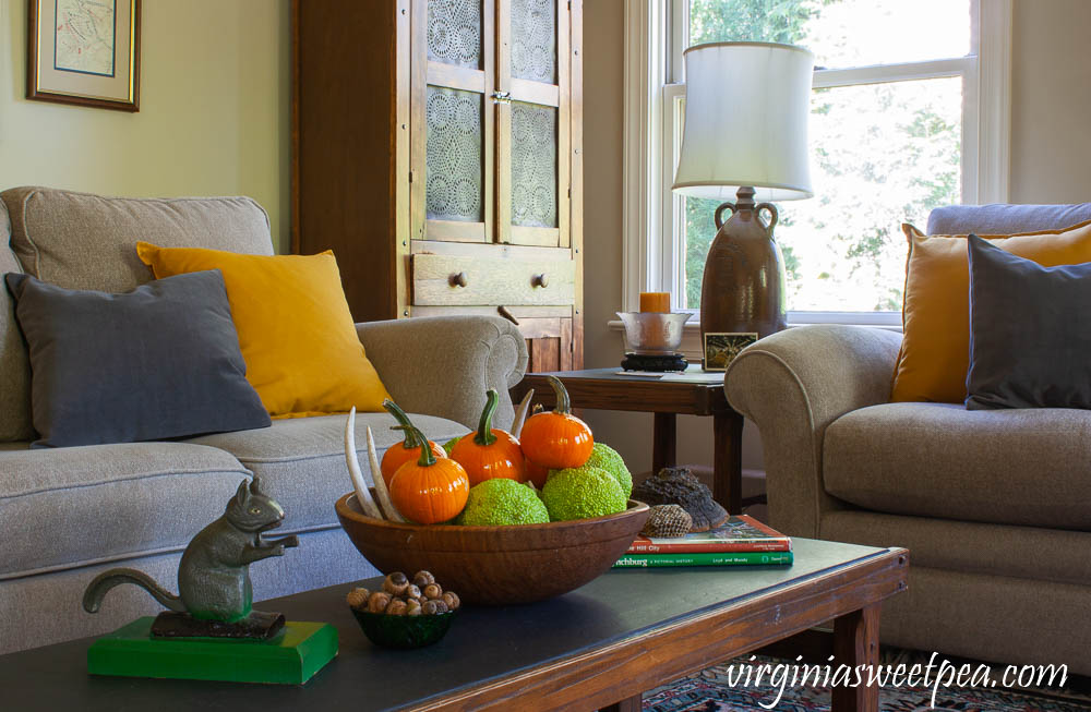 Coffee table decorated for fall with vintage.