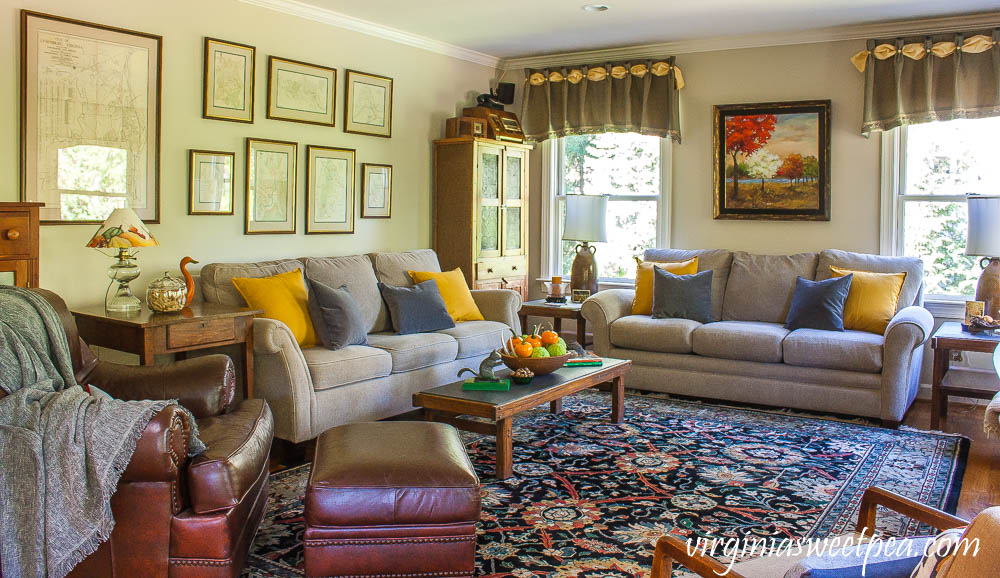 A traditional southern family room is decorated for fall with vintage.