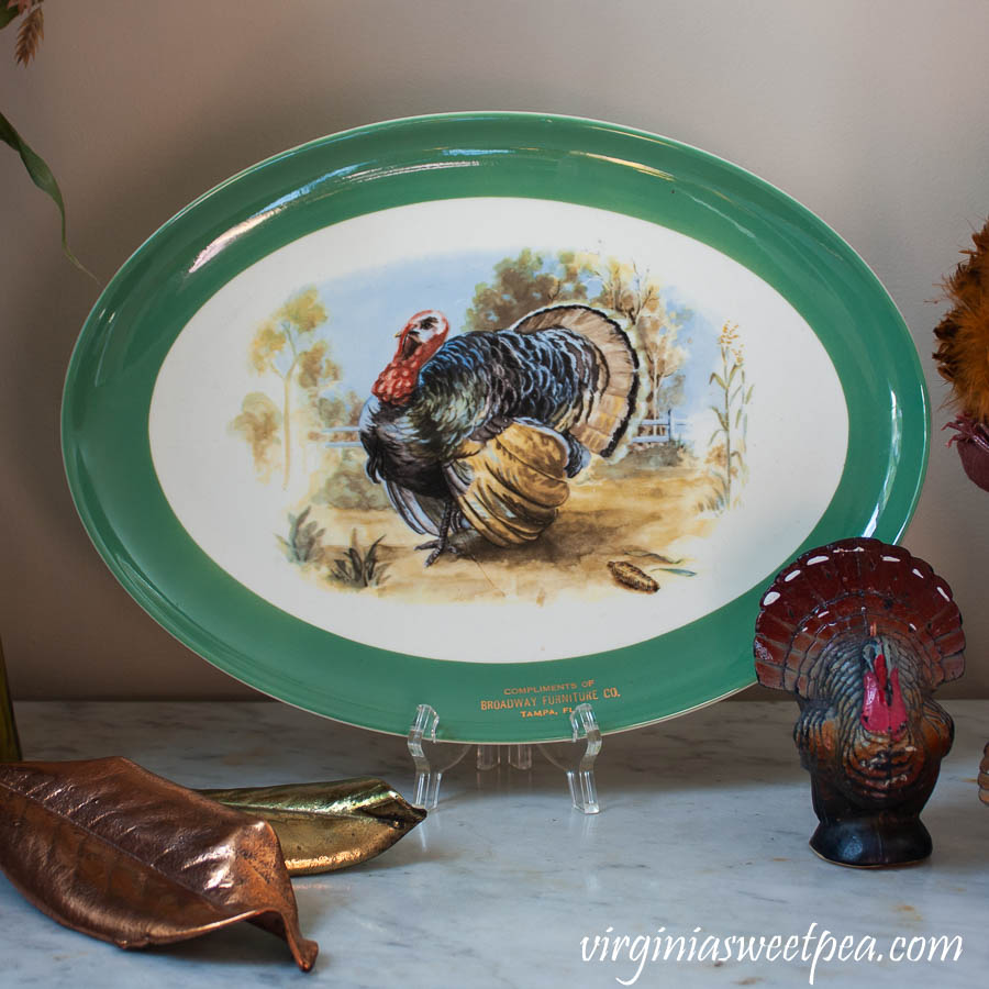 Vintage turkey platter with a vintage turkey candle