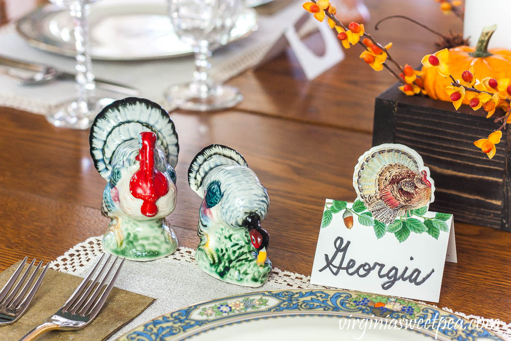 Thanksgiving table with a Caspari turkey place card and vintage turkey salt and pepper shakers
