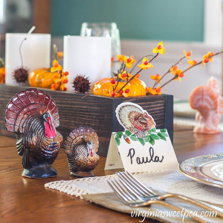 Thanksgiving table with a Caspari turkey place card and vintage turkeys