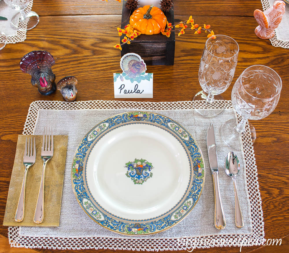 Thanksgiving Place setting with vintage turkeys, a Caspari turkey place card, vintage turkey candles, Lenox Autumn dishes, vintage Rock Sharp crystal, and Gorham Golden Ribbon Edge Silverware.