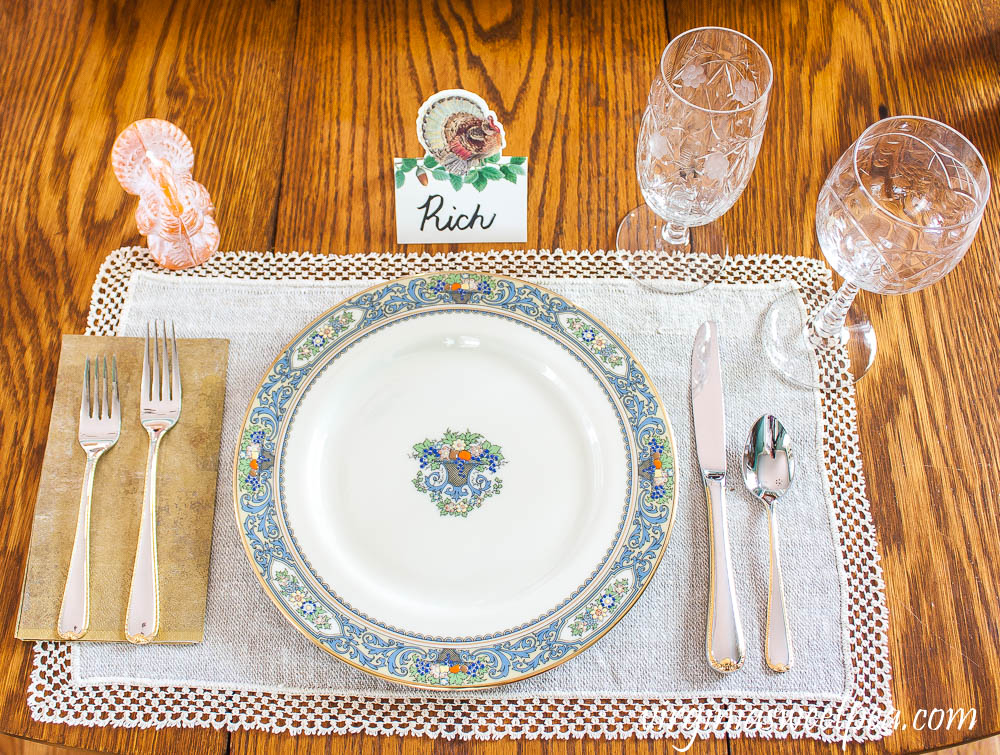 Thanksgiving Place setting with vintage turkeys, a Caspari turkey place card, beeswax turkey candle, Lenox Autumn dishes, vintage Rock Sharp crystal, and Gorham Golden Ribbon Edge Silverware.