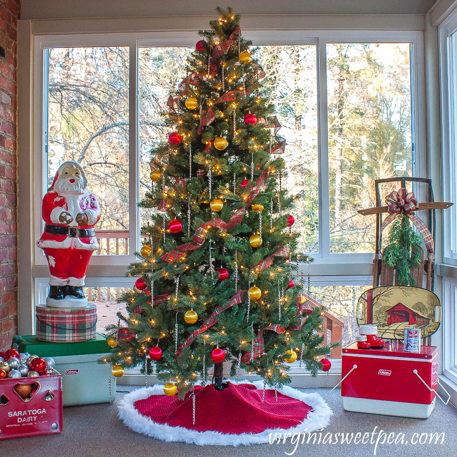 A Very Vintage Christmas on the Porch - An enclosed porch is decorated for Christmas with a vintage Santa blow mold, vintage coolers, a vintage sled, and more.
