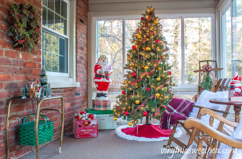 Sunroom decorated for Christmas with vintage.