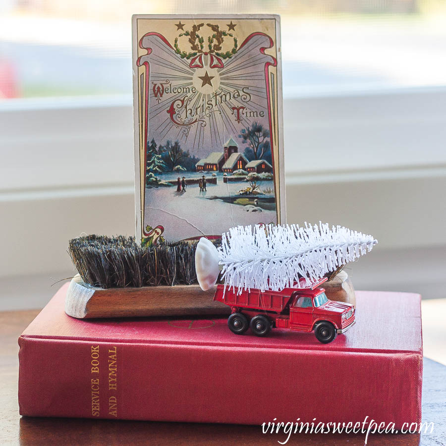 1910 Christmas postcard, vintage shoe brush, vintage Matchbox truck and a 1958 hymnal.