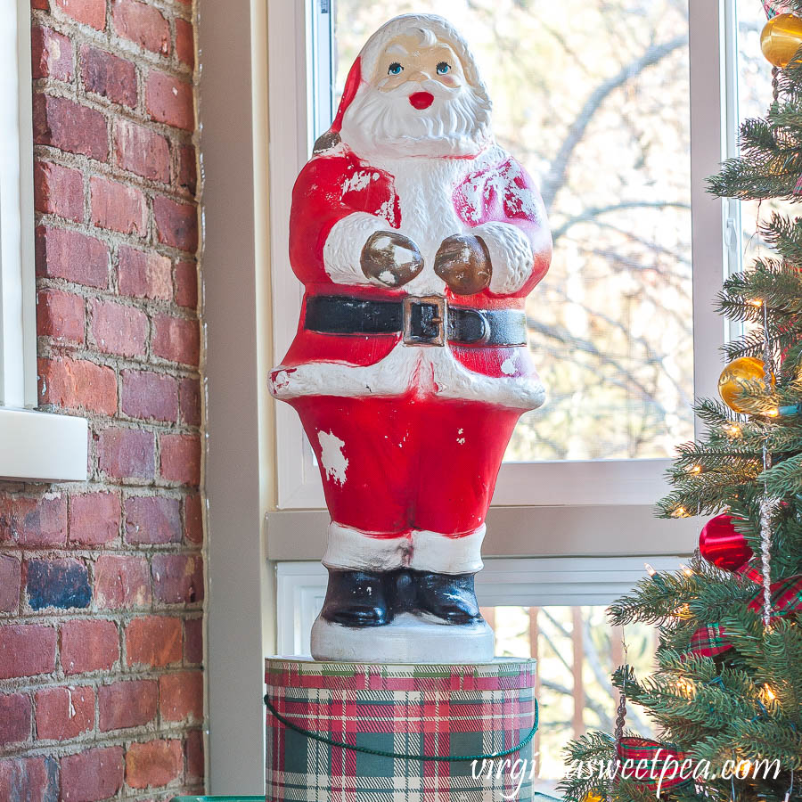 A Very Vintage Christmas on the Porch - Blow mold Santa on a vintage plaid hat box