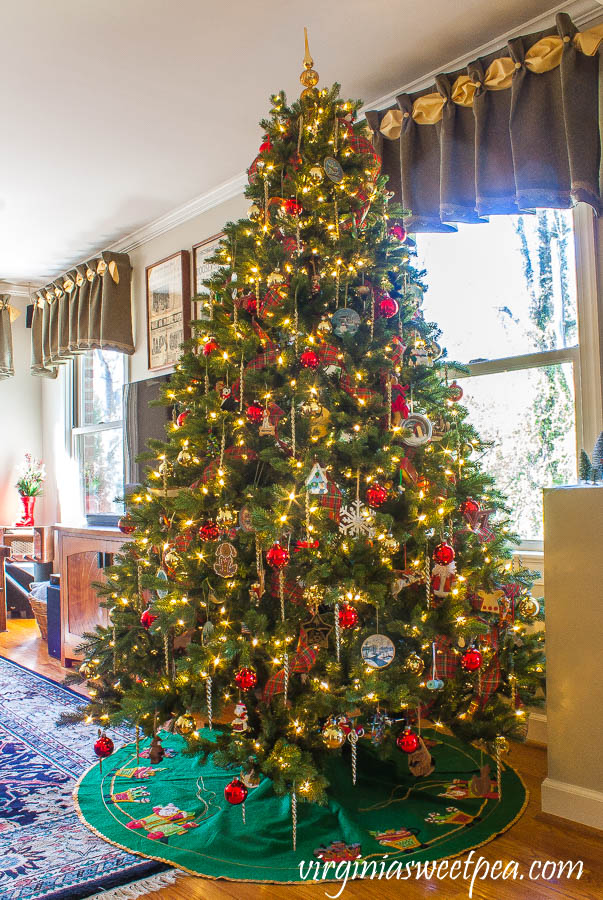 Family room Christmas tree decorated with ornament collected over 25 years.