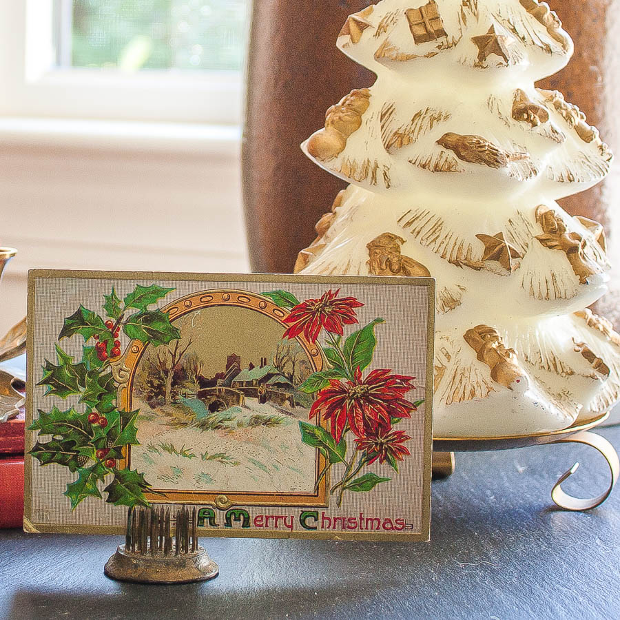 Early 1900's Christmas postcard and a vintage Christmas tree candle