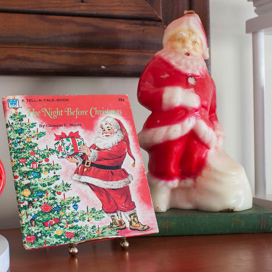 1976 The Night Before Christmas Book and a vintage Santa candle