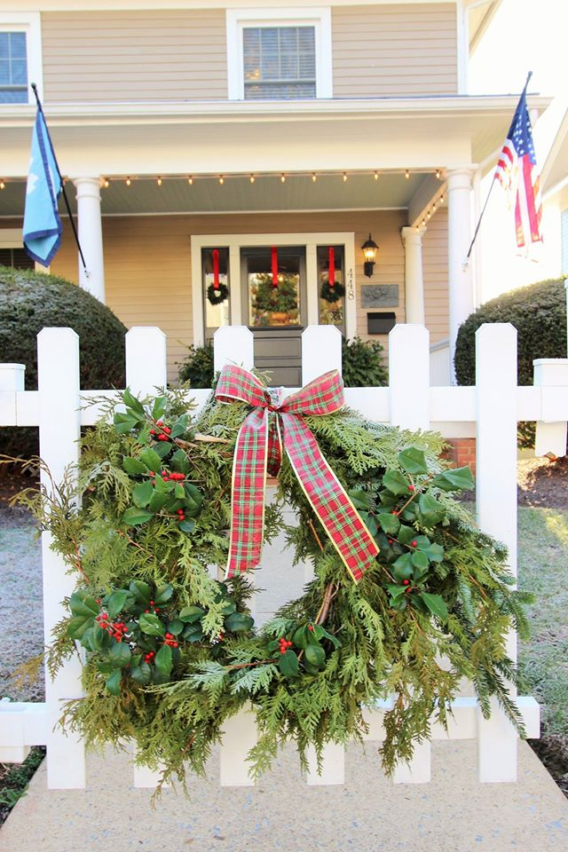 Live greenery wreath made with pine and holly.