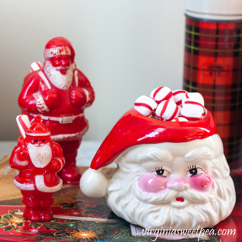 Vintage plastic Santa candy holders and a vintage Santa mug