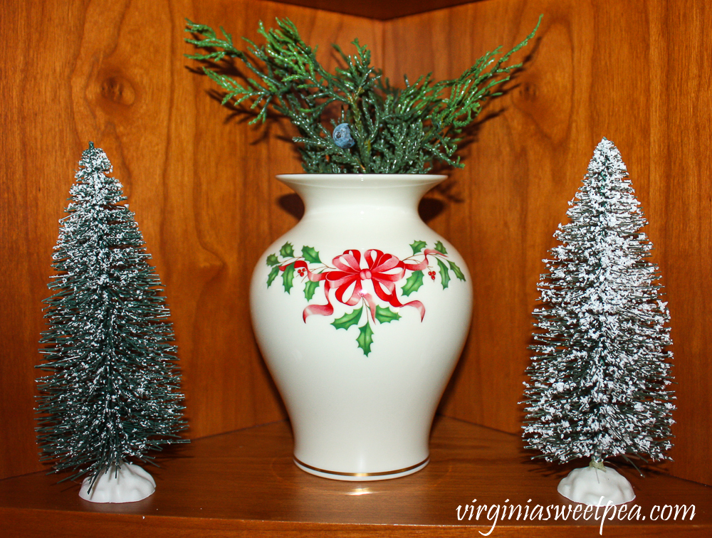 Kitchen shelf decorated for Christmas with Lenox Holiday star and bottlebrush trees