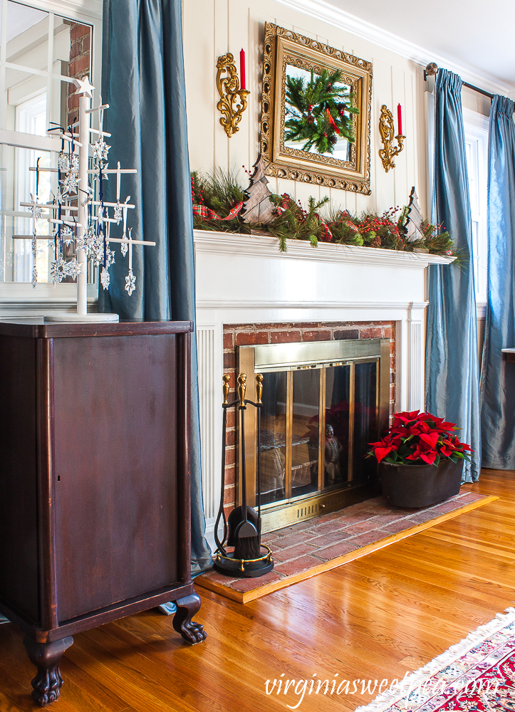 Christmas mantel decorated in a warm and rustic style with vintage