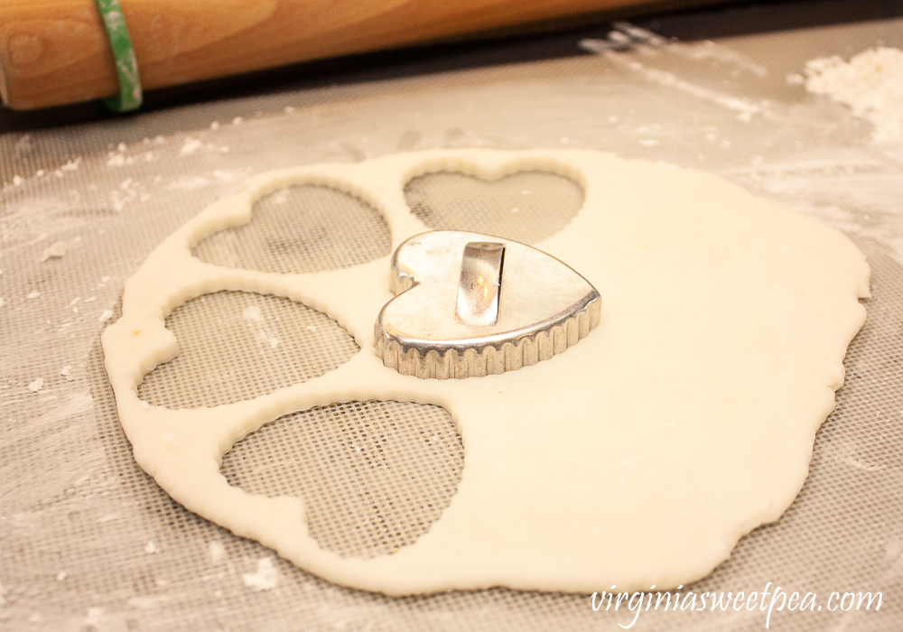 Cutting out hearts with a vintage heart cookie cutter