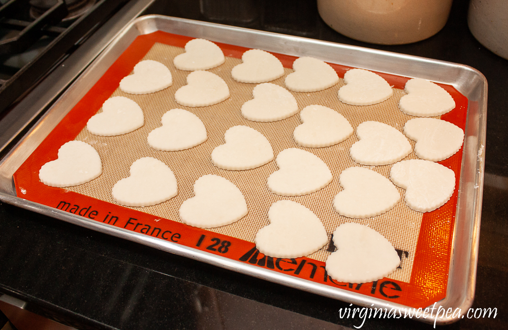 Hearts made with baking soda and cornstarch on a baking sheet with a Silpat