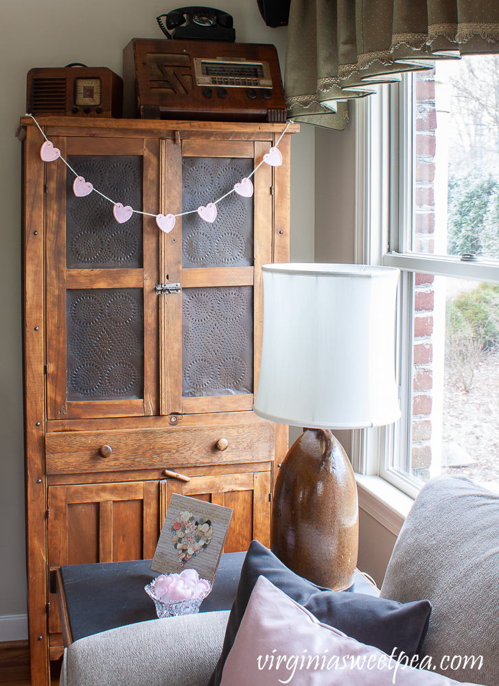 Heart Garland hanging on an antique pie safe