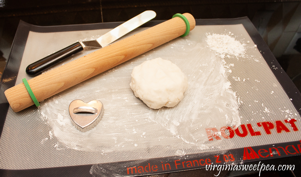 Dough made with cornstarch and baking soda with a rolling pin
