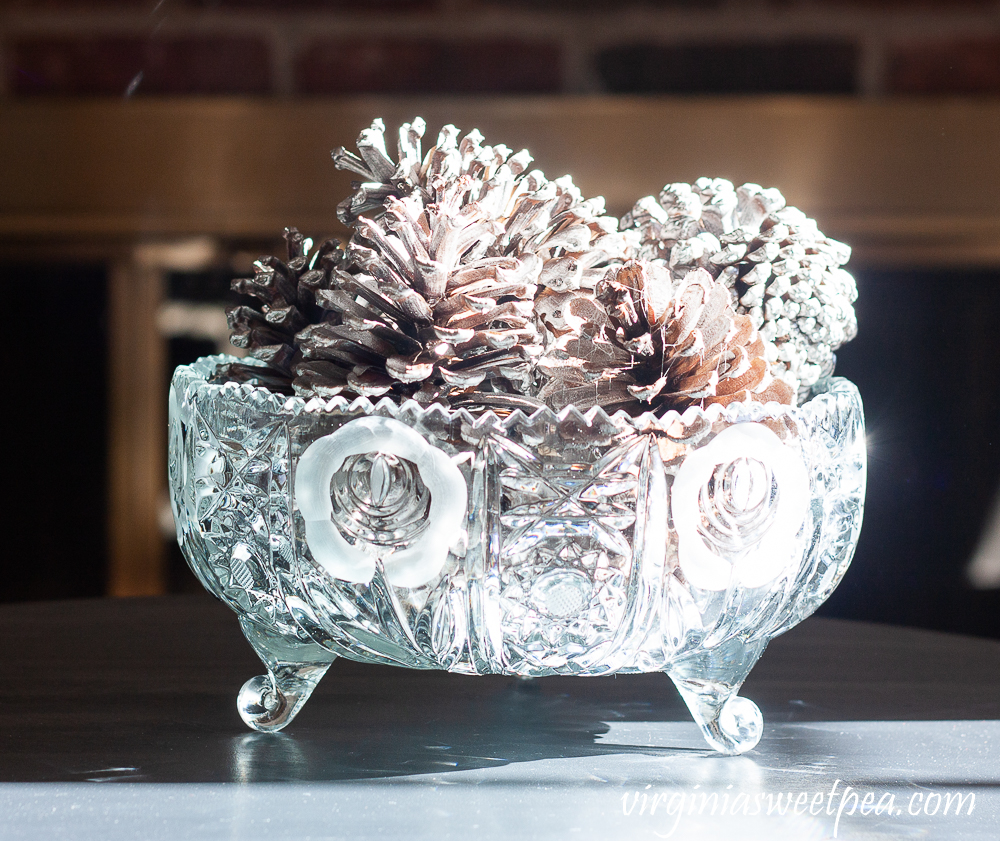 Pine Cones spray painted silver in an antique cut glass bowl.