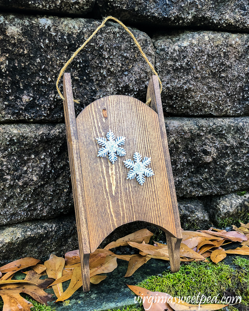 Wood sled made in the 1980s refinished and decorated with snowflakes.