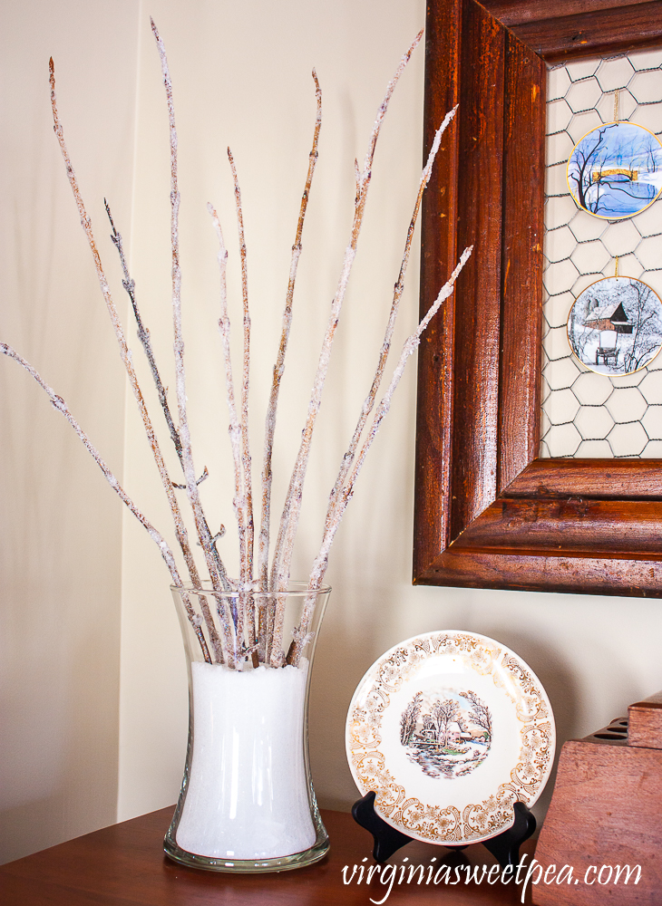 Branches with epsom salt glued to them displayed in epsom salt