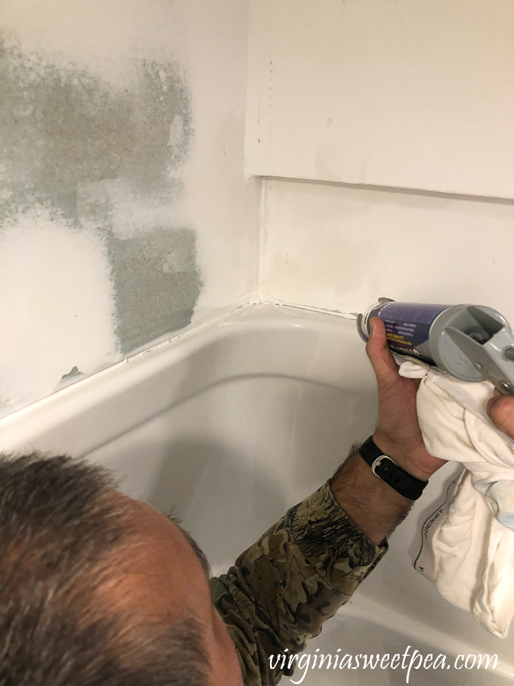 Caulking a shower