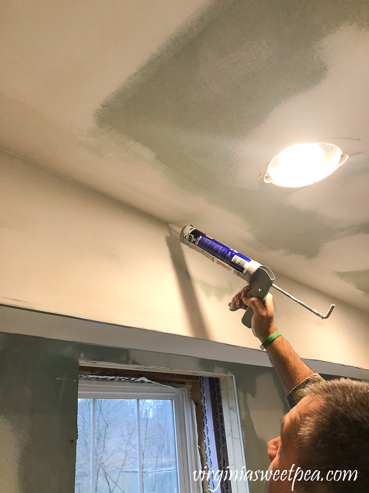 Caulking the ceiling in a basement