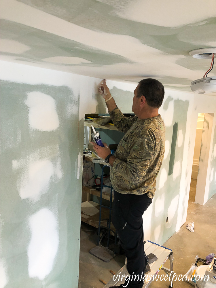 Smith Mountain Lake House Basement Project: Caulking the ceiling