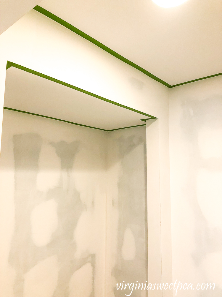 Ceiling taped with Frog Tape in preparation for painting walls