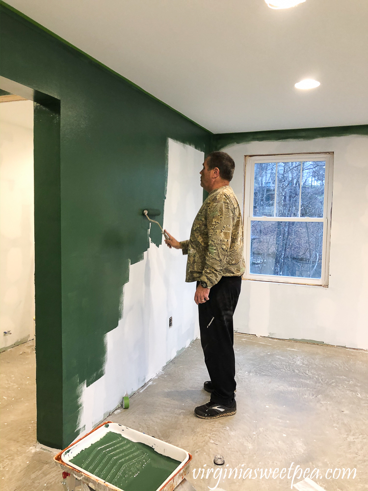 Painting walls with Sherwin Williams Emerald Paint in Rock Garden