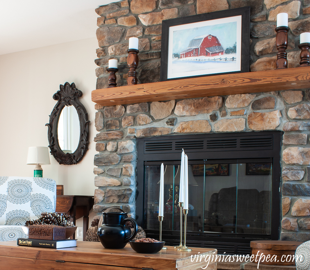Rock fireplace and coffee table in a cabin decorated for winter
