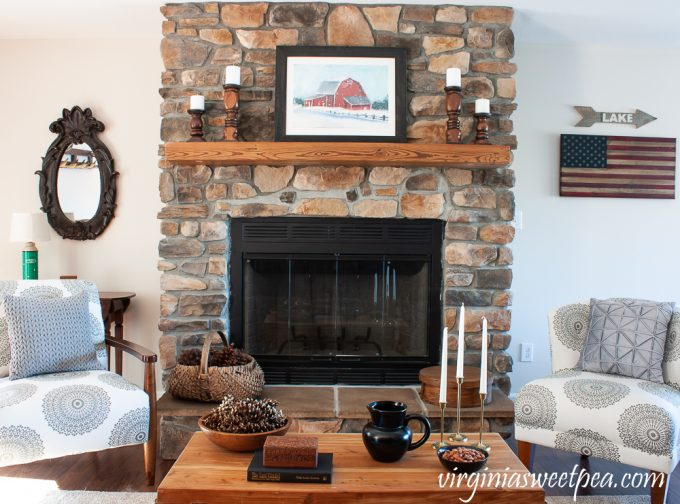 Rock fireplace in a cabin decorated for winter