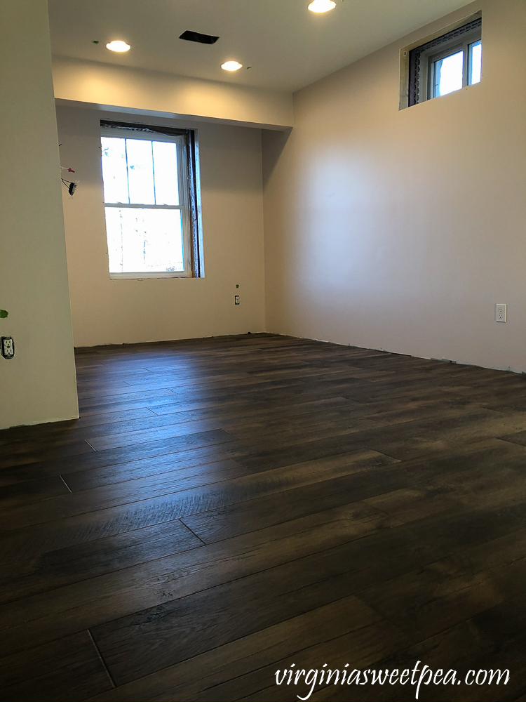 Mohawk Crest Loft flooring in Prairie Oak and Sherwin Williams Emerald Paint in Cultured Pearl