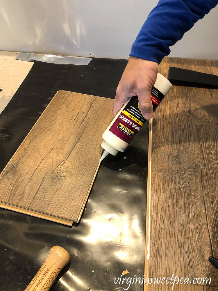 Installing Mohawk Crest Loft floor in Prairie Oak in a basement bathroom
